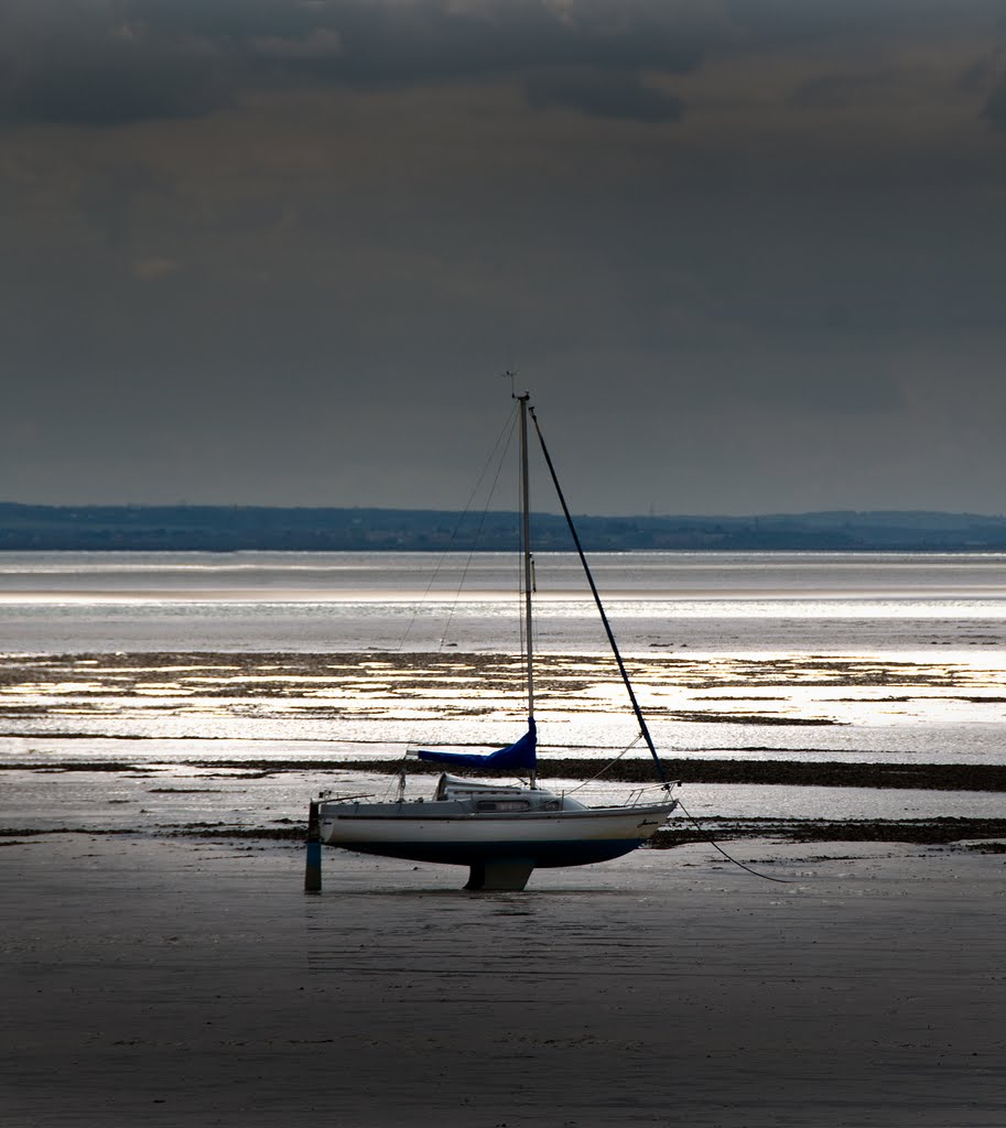 Silhouette of a beached yacht