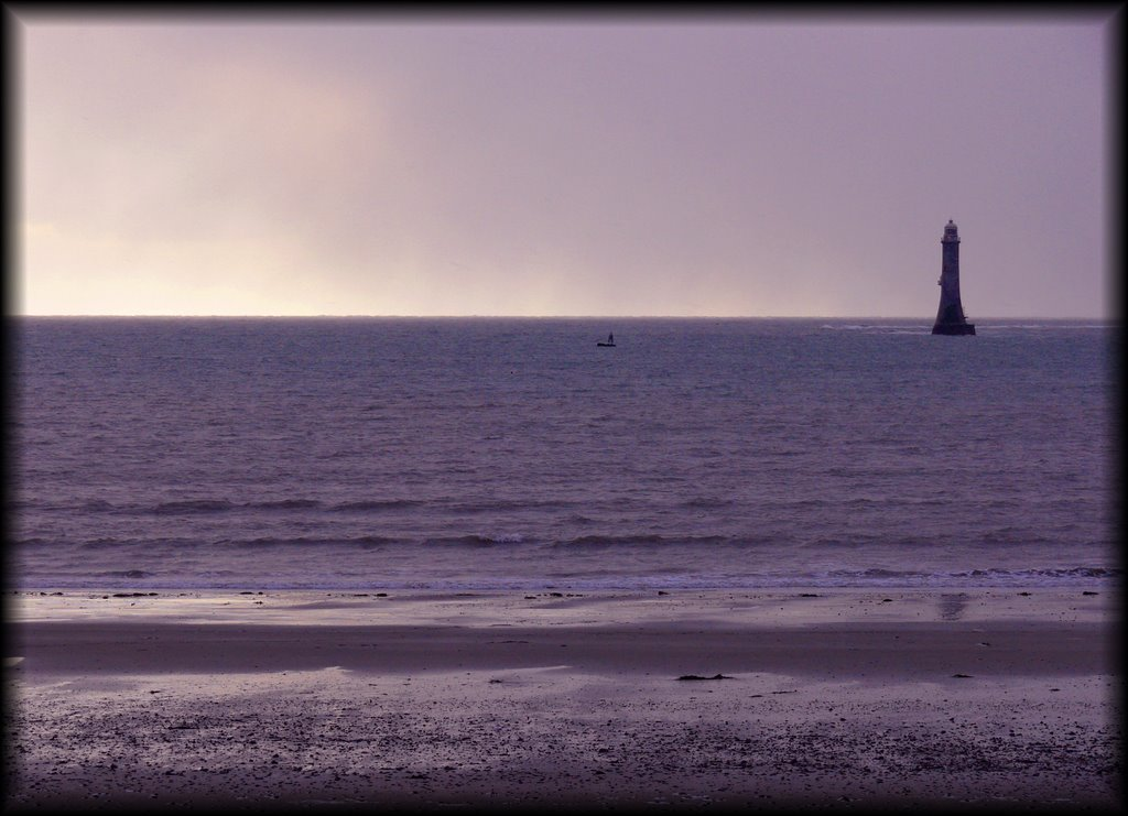 The HaulbowlineLighthouse, at the mouth of Carlingford Lough, awaits an approaching rain shower