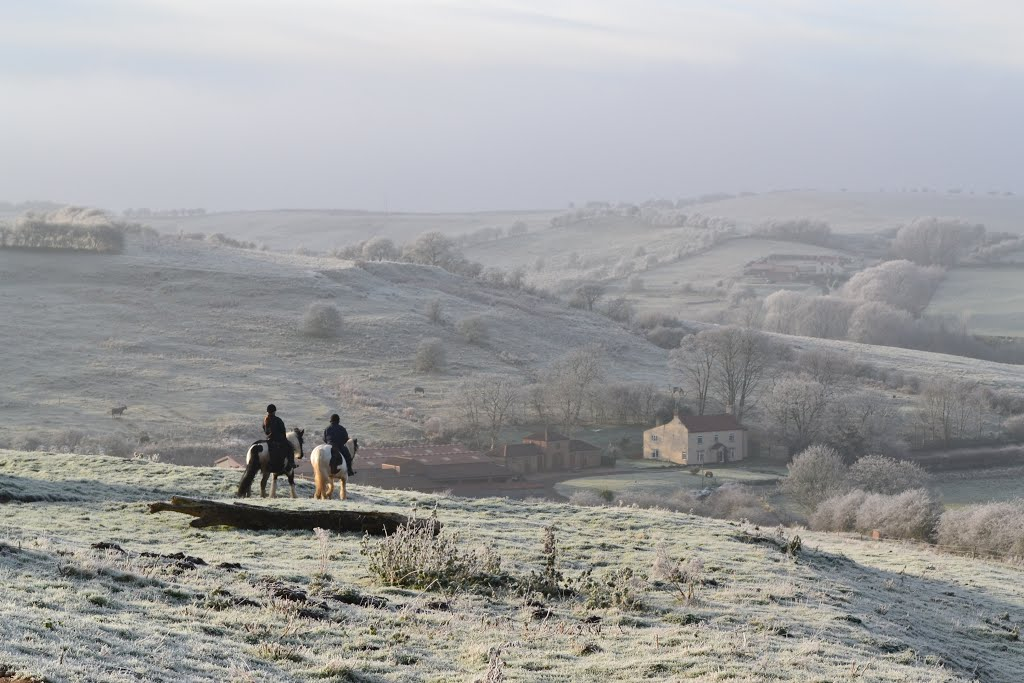 Winter riders overlooking Nettleton Grange in the Lincolnshire Wolds